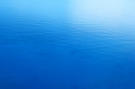 still water: Tranquil blue sea water background
