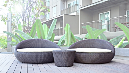 Relaxing rattan day beds in resort photo