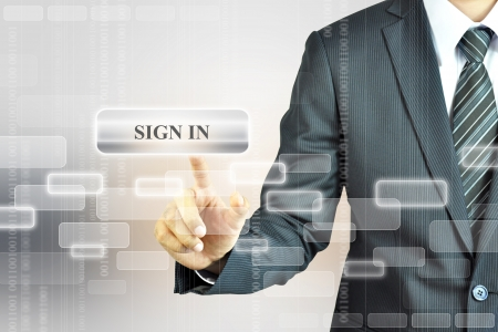 Businessman pushing SiGN IN sign photo