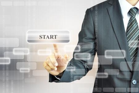 touching hands: Businessman pushing START sign Stock Photo