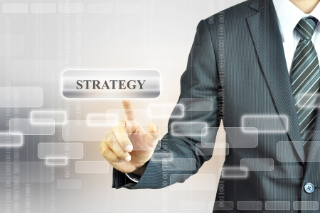 tactic: Businessman toching STRATEGY sign