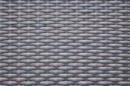 Dark brown woven rattan taxture background photo