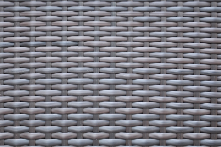 Dark brown woven rattan taxture background Stock Photo