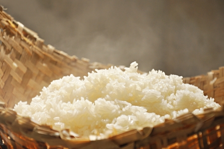 Cooked sticky rice  in wooden steamer photo