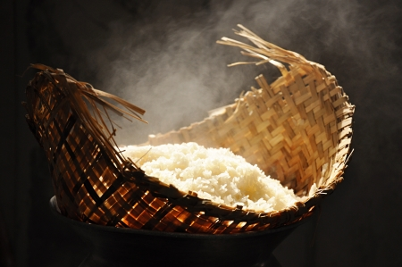 Sticky rice being cooked in wooden steamer photo