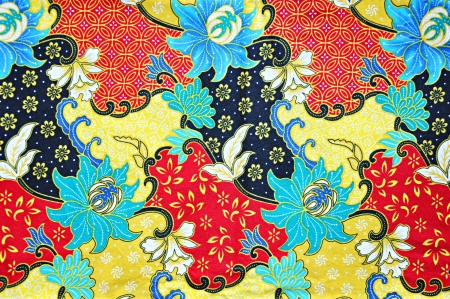 Colorful batik cloth fabric background photo