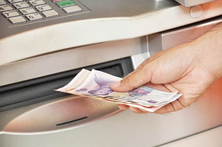automatic teller machine bank: Man taking money from ATM Stock Photo