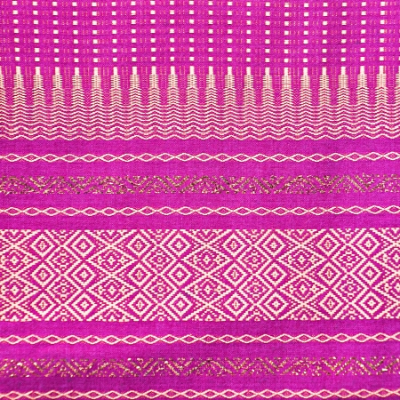 Thai style violet fabric pattern background photo