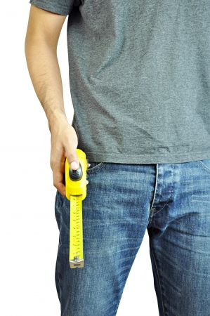 Worker holding a tape measure photo