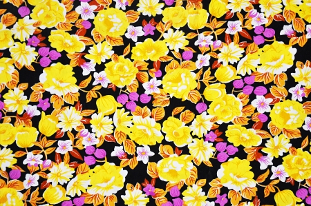 Yellow flower pattern on batik fabric - background photo
