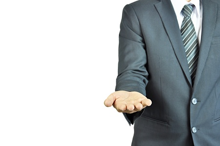 Businessman opening palm of the hand photo