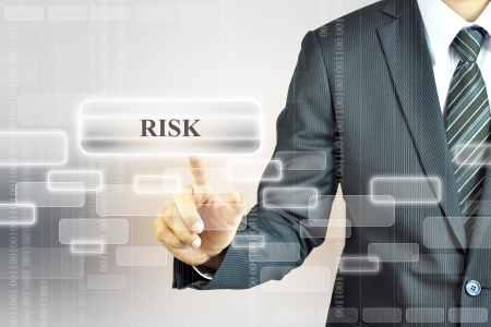 crisis management: Businessman pressing RISK sign Stock Photo