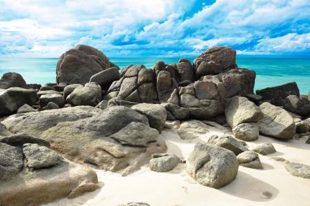 large rock: Rocks , sea and blue sky - Lipe island Thailand Stock Photo