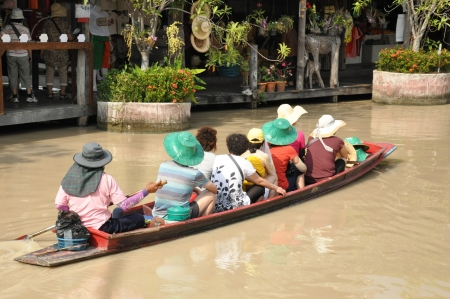 floating market: Tourists sailing on traditional thai long tail boat at Pattay floating market, Thailand