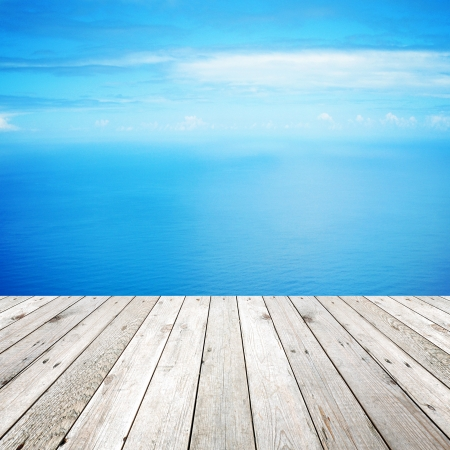 Wood, blue sea and sky background photo
