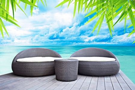 Rattan seat lounge beside the sea Stock Photo - 18820078