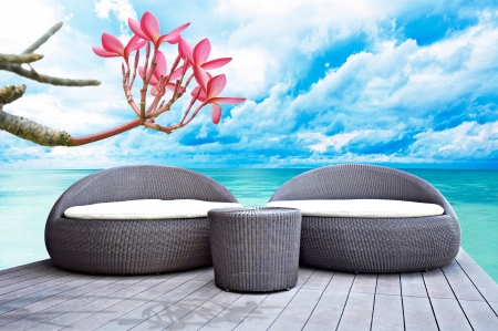 Rattan seat lounge beside the sea photo