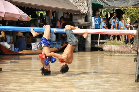 Pattaya Thailand - Mar 2   traditional water Thai boxing  or Muay Talay  showing at Pattaya floating market, Thailand  on Mar 2, 2013