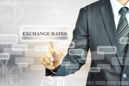 bank rate: Businessman touching Exchange Rate sign  Stock Photo