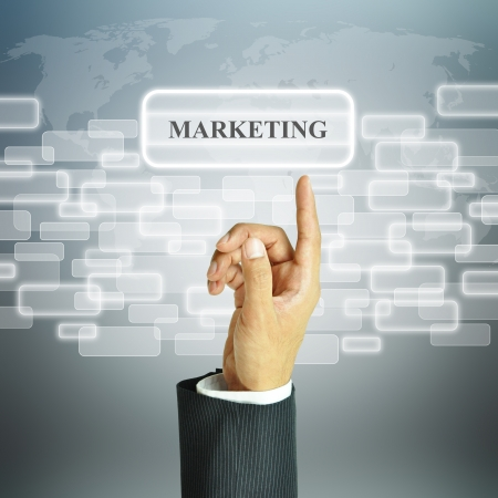Businessman hand pointing MARKETING sign photo