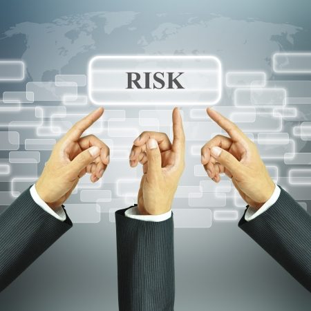 protection risks: Hands pointing to RISK sign Stock Photo