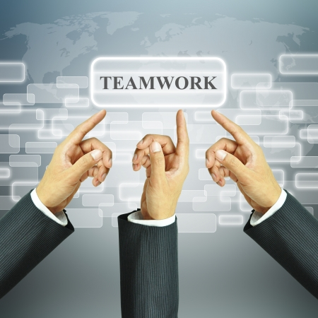 Businessman hands pointing to Teamwork sign photo