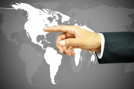 Businessman hand touching world map Stock Photo - 19917457