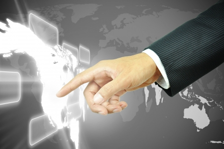 Businessman hand touching world map photo