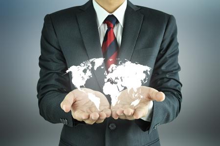 Businessman holding world map photo