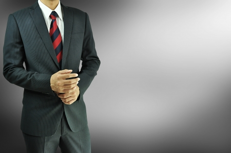 Standing businessman on gray background photo
