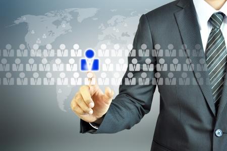 �resource: Empresario tocar signo de recursos humanos - recursos humanos, gesti�n de recursos humanos, el concepto de desarrollo de recursos humanos Foto de archivo