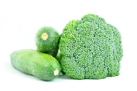 Broccoli and zucchinis on white background photo