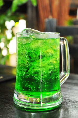 mocktail: Green soda softdrink with ice in the glass Stock Photo