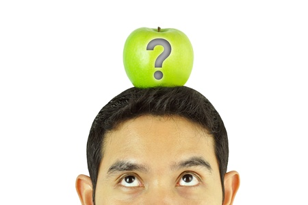A man thinking with apple on the head photo