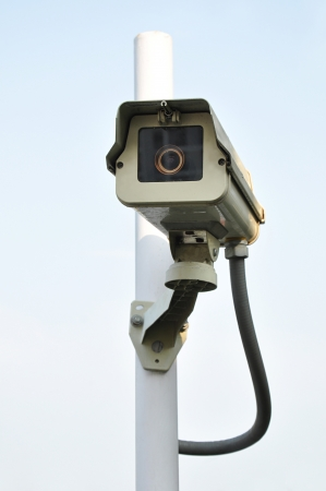CCTV on white post photo