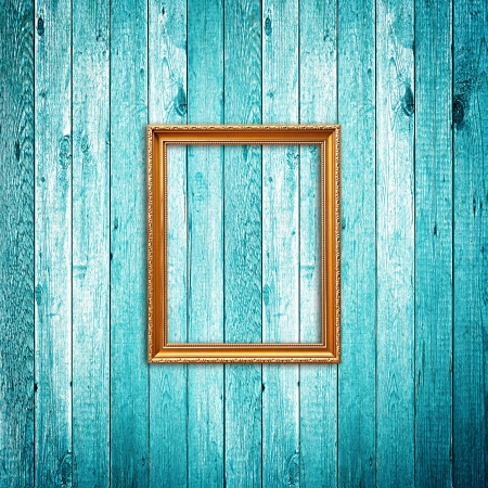 timber frame: Picture frame on blue wood background Stock Photo