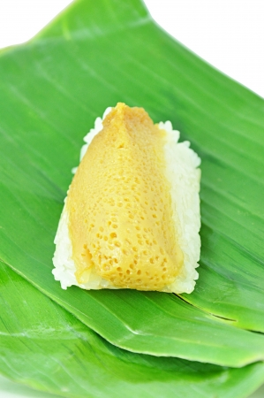 coconut sugar: Traditional Thai dessert - sweet sticky rice top with steamed egg custard on banana leaf