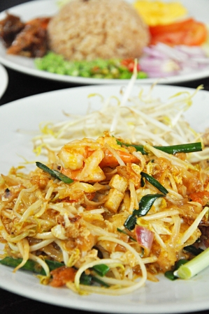 Yummy stir fried noodle with shrimps or Pad Thai - Thai Food photo