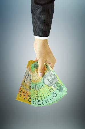 Businessman holding money - Australian dollars  AUD  photo