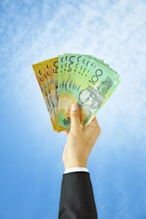 australian dollar notes: Businessman holding money - Australian dollars  AUD
