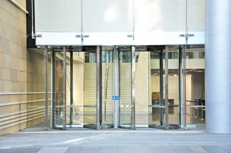 glass door: Entrance of the building - revolving doors