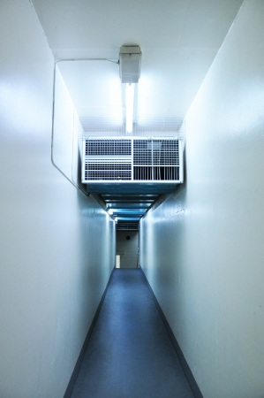 Long narrow corridor inside the building photo