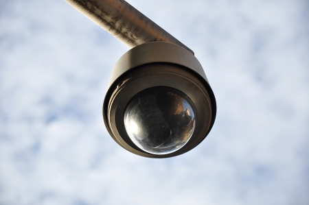 Round shape CCTV on cloudy sky background Stock Photo - 20027977