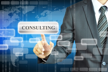 Businessman pressing CONSULTING sign photo