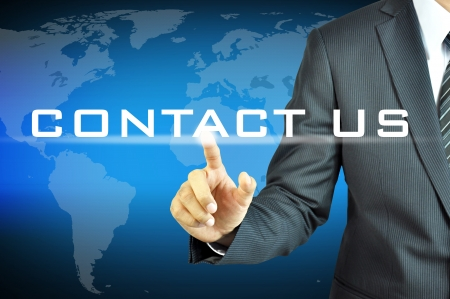 us: Busineaa man pointing Contact Us sign Stock Photo