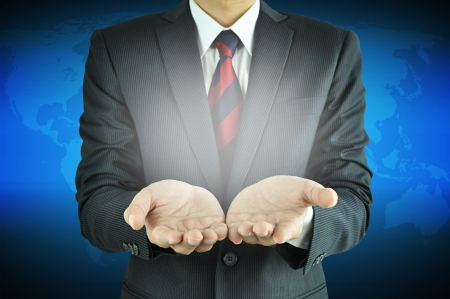 Businessman raising his palms - presenting concept Stock Photo - 20645813