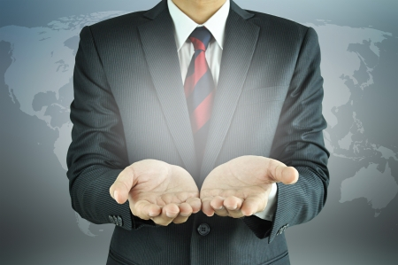 Businessman raising his palms - presenting concept Stock Photo - 20645811