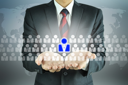 hr: Businessman holding Human Resources sign - HR, HRM, HRD concept