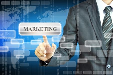 マーケティングの記号を触れる実業家 写真素材