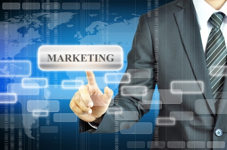 online marketing: Businessman touching MARKETING sign Stock Photo